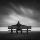 man-waiting-on-bench